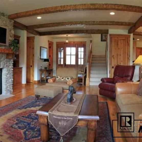 Cabins at Lake Catamount - Hardwood floors, rustic beams, river rock fireplace