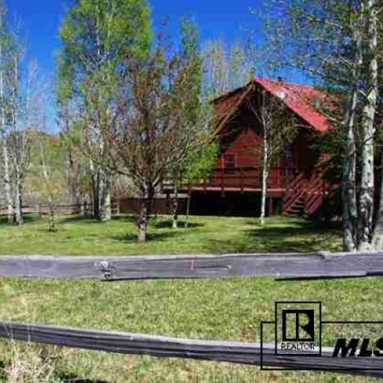Peaceful Country Living - Quaint log home on over 5 acres with terrific views overlooking Saddle Mountain, Sleeping Giant and Trout Creek<br />