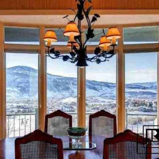 Stunning 6,000 SF Home - High above it all - stunning views of the Flattops and Rollingstone Golf Course. <br />