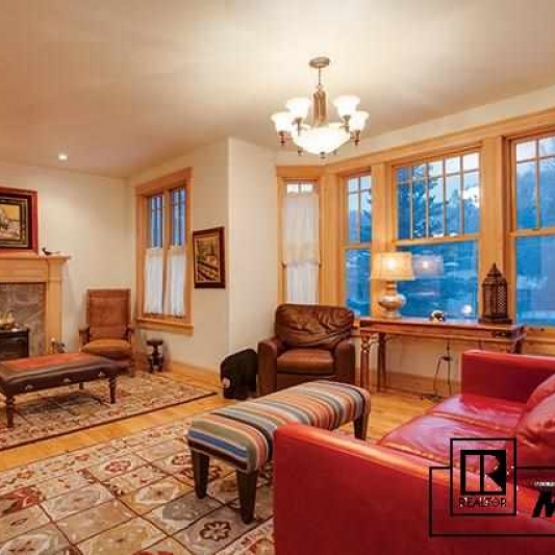 Victorian Beauty - Immaculate home with gas fp, open kitchen, wet bar,  hickory wood floors, & cherry cabinetry<br />