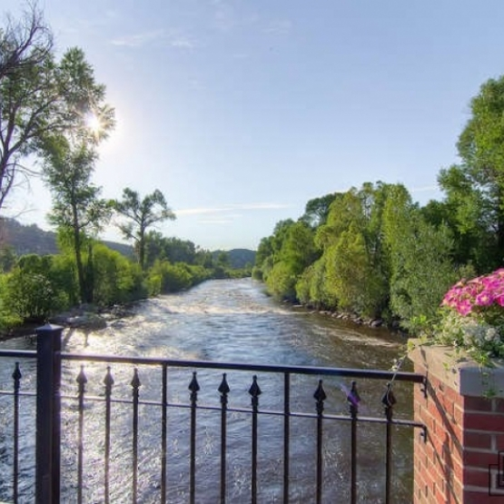 The Olympian #201 - Overlooking the Yampa River and just a block from Steamboat's main attractions<br />