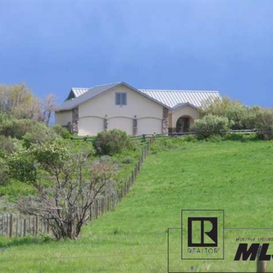 Elk River Valley Ranch - 35acre property highlights beautiful gardens, a barn, fenced pastures, and a custom 3,400 SF home<br />