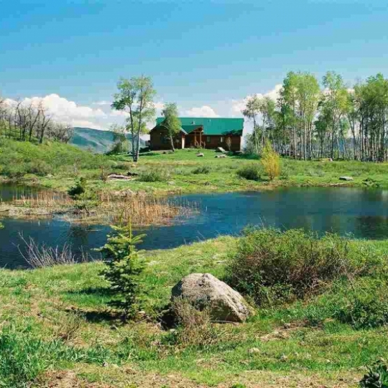 Valley Home with Pond - Elk River Area ranchette on 35 acres