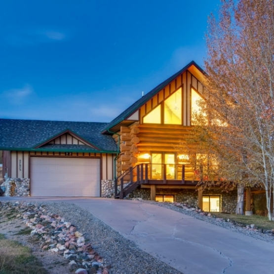 Silver Spur Log Home - Log Home bordering open space with wrap around deck and incredible views <br />